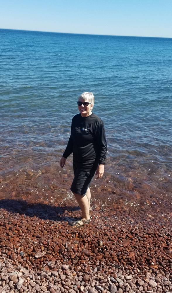 Phyllis testing the waters of retirement during an excursion on Lake Superior.